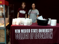 Education students proudly serve popsicles and popcorn in O'Donnell Hall.