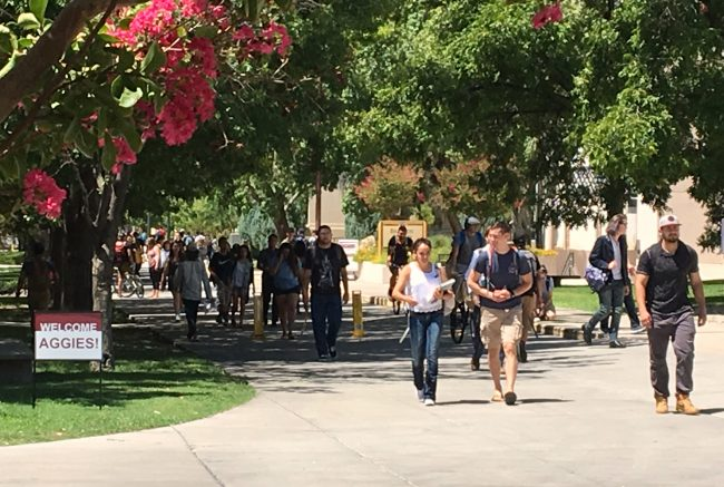 Frenger Mall on the NMSU main campus in Las Cruces is crowded with students Wednesday, August 16, 2017, on the first official day of the 2017 fall semester. Overall enrollment at the Las Cruces campus is down 1.7 percent this semester, but first- time freshmen enrollment increased by 12.3 percent over last year. (Kokopelli Photo)