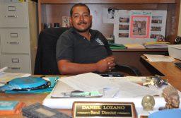 Daniel Lozano sits at his office desk at Santa Teresa High School in Santa Teresa, New Mexico. (Photo by Amanda Granados/Kokopelli)