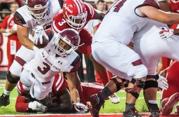 Aggie running back Larry Rose lll dives into the end zone Saturday against the University of Louisiana Ragin' Cajuns in Lafayette. The Aggies went on to lose the game 47–34, falling to 4–6, 2–4 overall. Rose had three touchdowns on the night. (Photo courtesy of NMSU athletics)