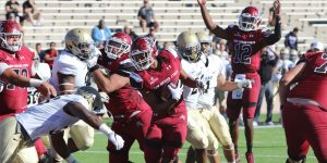 The NMSU Aggies run the ball against the Idaho Vandals on their way to a 17–10 victory at Aggie Memorial Stadium. The Aggies improved to 5–6 overall and are one win away from bowl eligibility. (Photo courtesy of NMSU athletics)