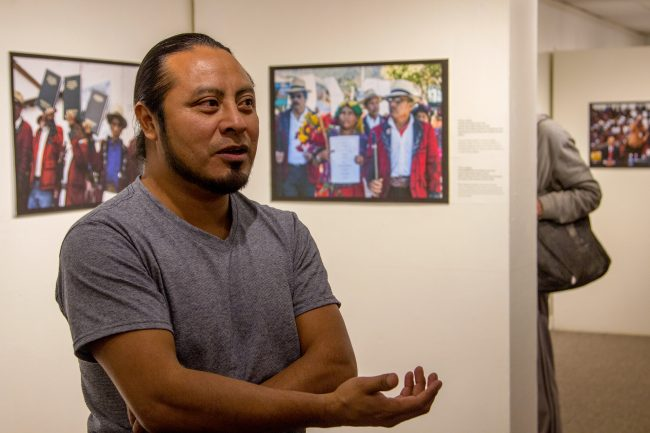 "Documentary photographer Roderico Y. Diaz talks about his exhibit, ""Defending Truth and Memory: The Path Towards Justice in Guatemala,"" at the University Museum at Kent Hall on Feb. 1. The exhibit will be on display through June 30.  (Photo by Maggie Adams / Kokopelli)"