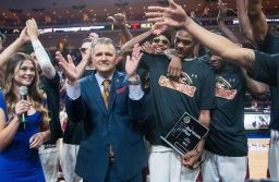 New Mexico State men's basketball team and head coach Chris Jans celebrate the WAC championship March 10 in Las Vegas, Nevada.