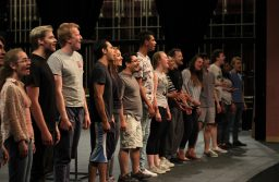 """The ensemble cast of NMSU's production of """"RENT,"""" April 17, 2018, reciting the song """"Seasons of Love"""" at their rehearsal in the NMSU Center for the Arts. (Photo by Nicholas Arias/Kokopelli)"""