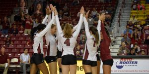 The New Mexico State Aggie volleyball team raises hands in celebration during the New Mexico State season home opener against Grambling State on Tuesday Sept. 4, 2018, at the Pan American Center. (Photo by Eli Whitney/Kokopelli)