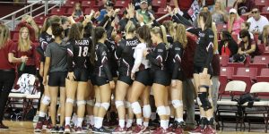 The New Mexico State volleyball team in between sets during the New Mexico State home win against Arizona on Sept. 8, 2018, at the Pan American Center. (Photo by Eli Whitney/Kokopelli)