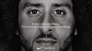 "A black and white close of photo of Colin Kaepernick with the the text ""Believe in something. Even if it means sacrificing everything."" over it."