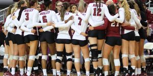 The NMSU volleyball team huddles to talk to coach Mike Jordan before the home match against WAC opponent Utah Valley on Thursday, Oct. 18, 2018, at the Pan American Center. (Photo by Eli Whitney/Kokopelli)