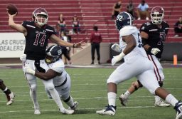 Aggie freshman Josh Adkins attempts to throw the ball while he gets tackled during a home game against Georgia Southern at Aggie Memorial Stadium, Saturday, Oct. 20, 2018. (Photo by Eli Whitney/Kokopelli)