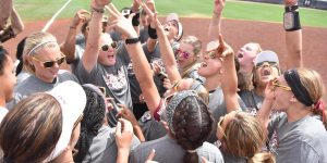 The New Mexico State softball team celebrates winning the WAC tournament during the 2018 season. (Photo courtesy of NMSU Athletics)
