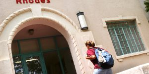 A student enters Rhodes Garrett Hamiel, the oldest residence hall on the NMSU campus. RGH offers different living arrangements to first-year students with rates ranging from $3,900 to $7,040 per semester. (NMSU Photo)