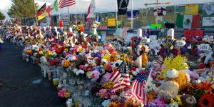 The memorial for victims of the El Paso shooting appears larger than ever Sunday, Sept. 8. Community members, including loved ones and friends of the victims, continue to add candles, flowers, flags and other mementos to the memorial site, which is located just behind the Walmart store where last month's deadly mass shooting claimed the lives of 22 people and injured dozens more. (Photo by Olivia Belcher/Kokopelli)