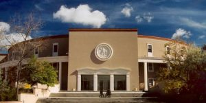 The New Mexico State Capitol building in Santa Fe, New Mexico, (aka the Roundouse), is home to the New Mexico state legislature. The 54th legislative session just adjourned Feb. 20, 2020. (Photo by Einar Einarsson Kvaran courtesy of WikiCommons)