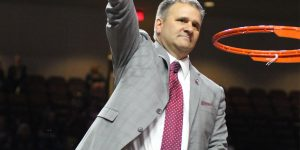 New Mexico State head coach Chris Jans holds the victory net after winning the 2019 Western Athletic Conference Tournament championship over Grand Canyon, Saturday, March 16, 2019, at Orleans Arena in Las Vegas. (Photo by Eli K. Whitney/Kokopelli)
